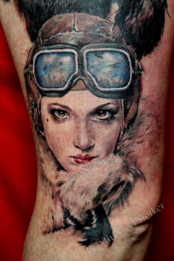 Charming young pilot lady 3D realistic colored portrait tattoo on leg
