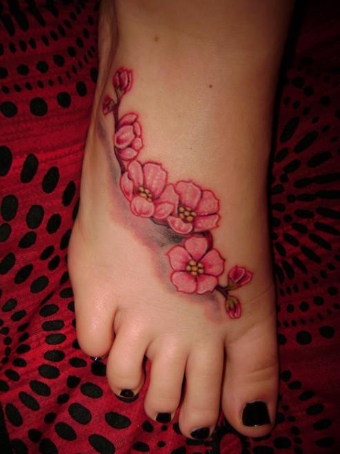 bel ramo di ciliegio fiorito tatuaggio su piede