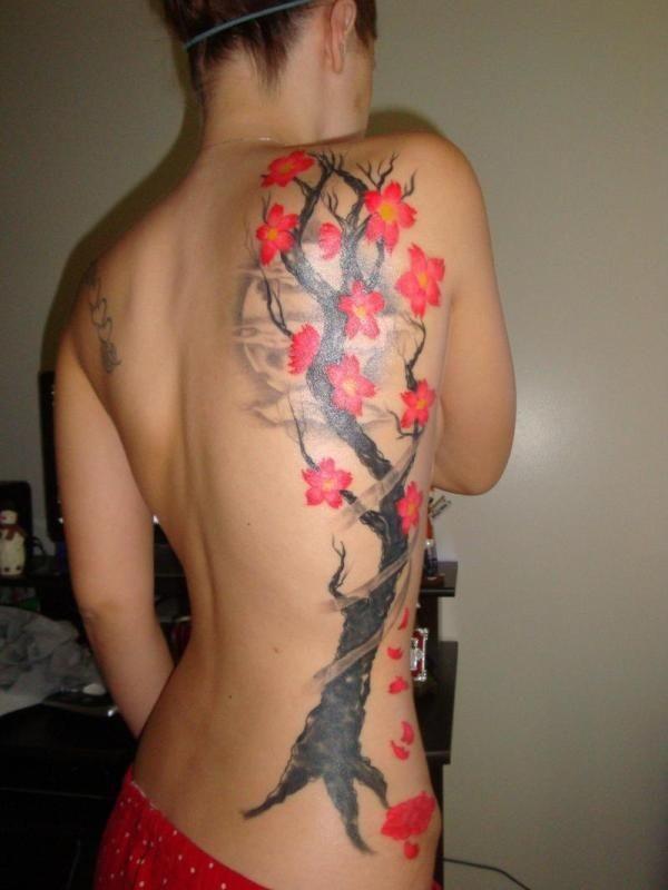 Cherry blossom tree tattoo on ribs