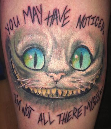 Amazing cheshire cat smile artwork tattoo