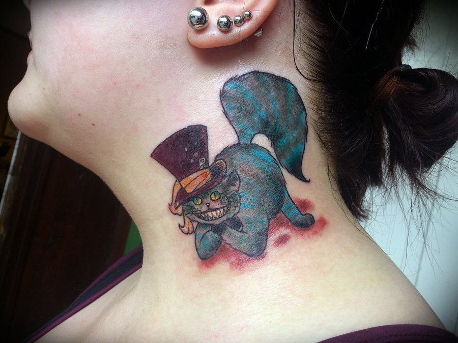 Cheshire cat in cylinder tattoo on neck