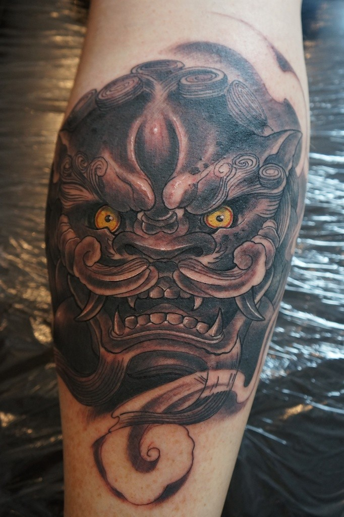 Chinese lion head tattoo on leg by graynd