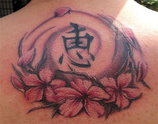 Chinese tattoo with cherry blossom and symbol on back