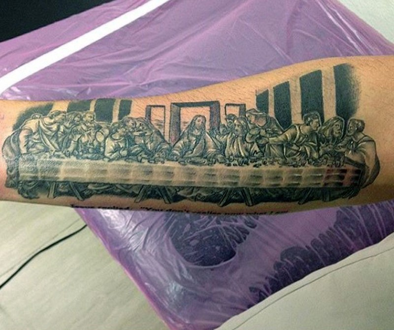 Christian themed black and white Lord&quots Supper picture tattoo on arm