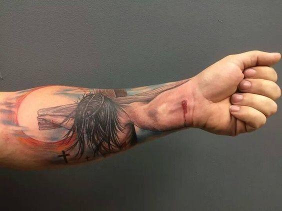 Christian themed colored Jesus on cross wrist tattoo