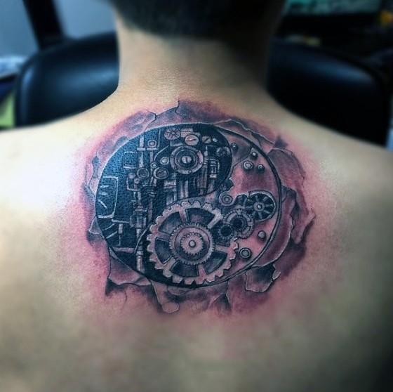 Circle shaped black ink detailed mechanism tattoo on upper back