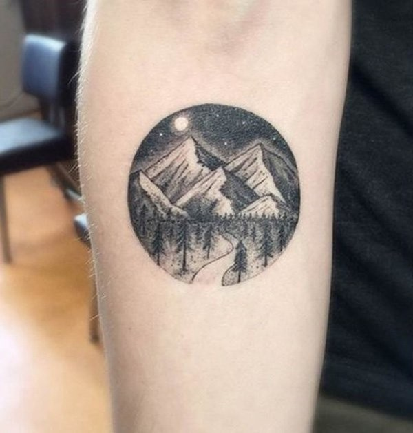 Circle shaped black ink night mountains with forest