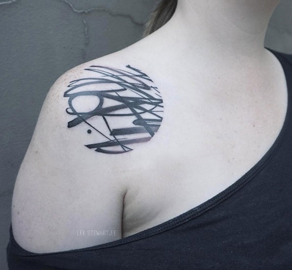 Circle shaped black ink shoulder tattoo of various ornaments