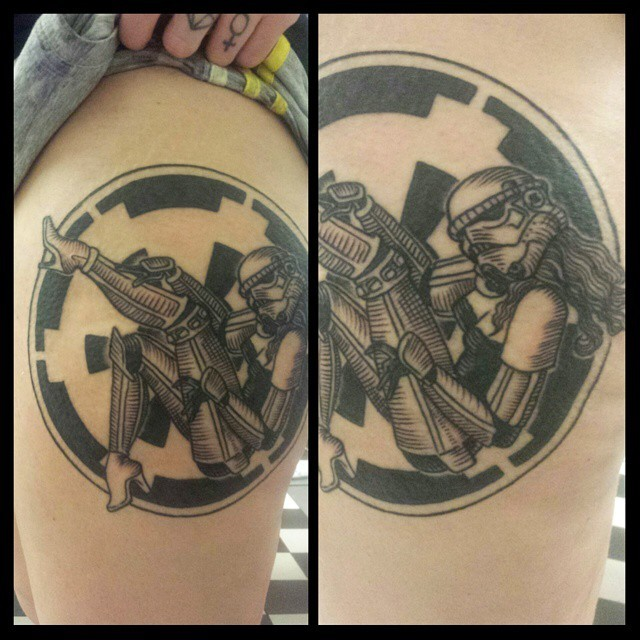 Circle shaped black ink thigh tattoo of sexy storm trooper woman