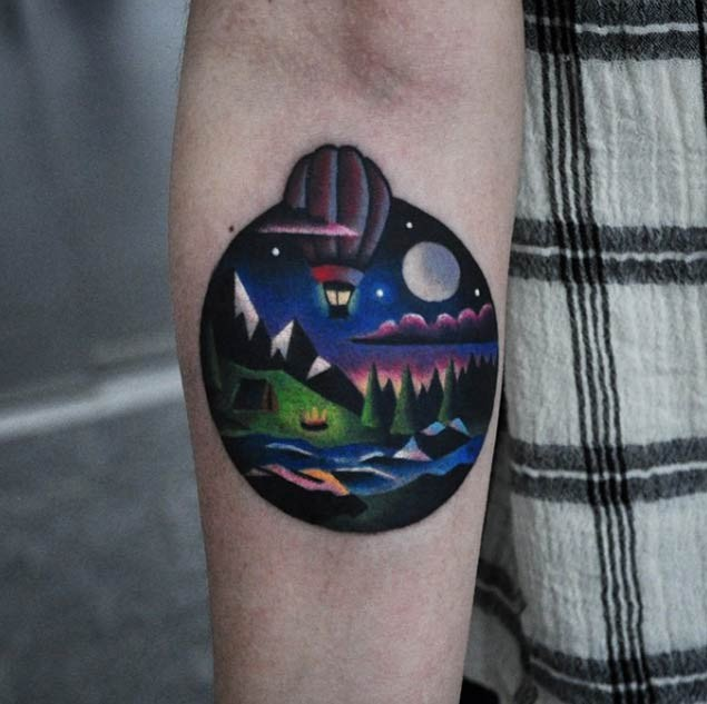 Circle shaped colored forearm tattoo of night forest with balloon