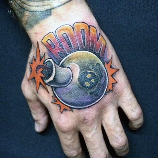Circle shaped colored hand tattoo of funny bomb and lettering