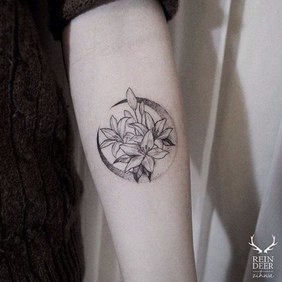 Circle shaped cute painted by Zihwa tattoo of flowers and moon