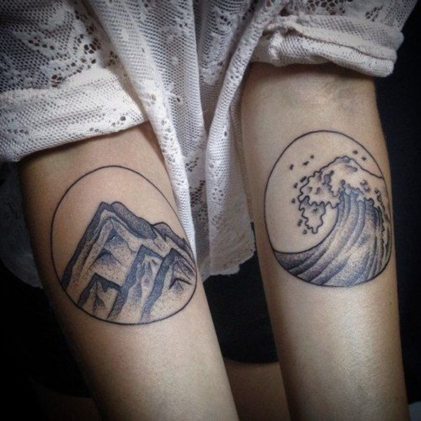 Circle shaped forearms tattoo of mountains and waves
