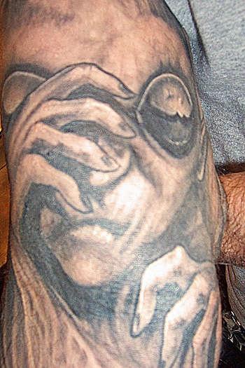 Classic gray alien tattoo