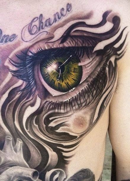 Clock in eye pupil tattoo by John Duffy on chest