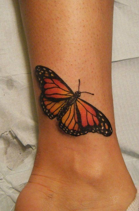 Color butterfly tattoo on leg