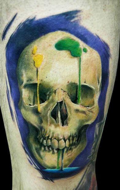 Human skull with ink splash tattoo