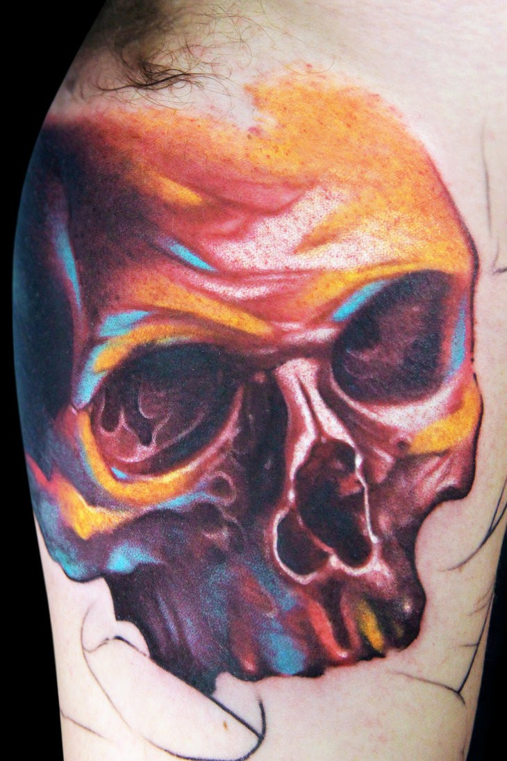 Watercolor skull tattoo on the arm