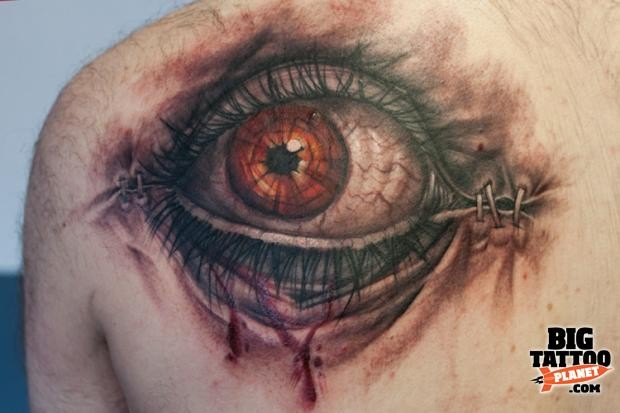 Colored 3D style realistic looking human eye tattoo on back