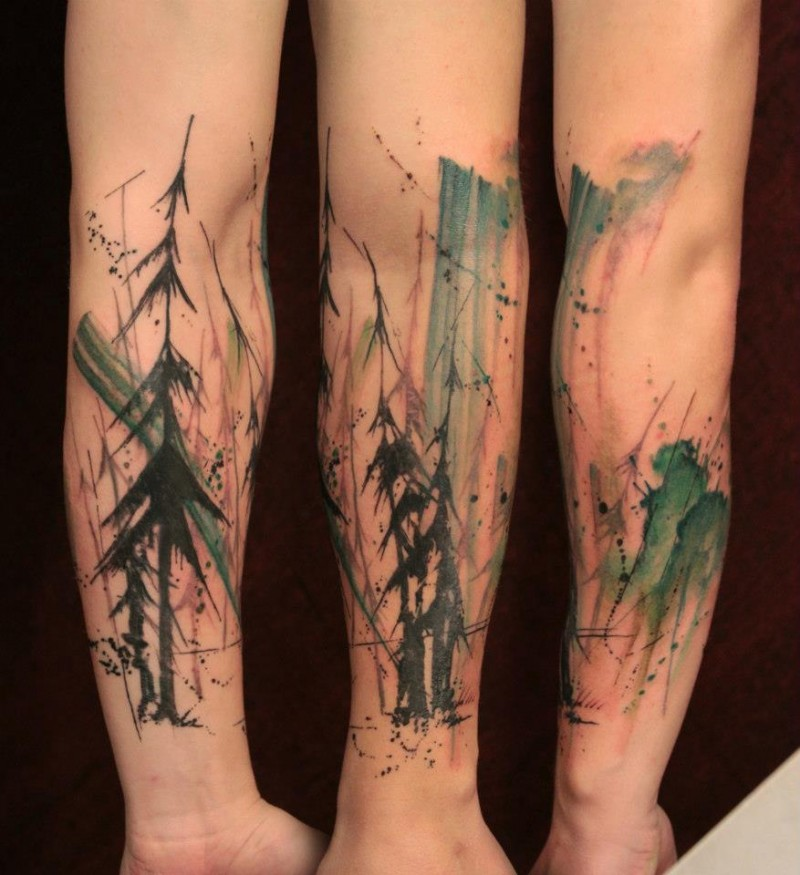 Colored abstract style forearm tattoo of dark forest and trees