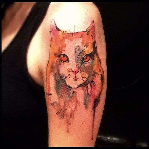 Colored abstract style shoulder tattoo of typical cat