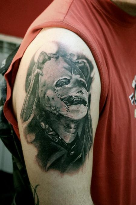 Colored amazing looking shoulder tattoo of famous band singer