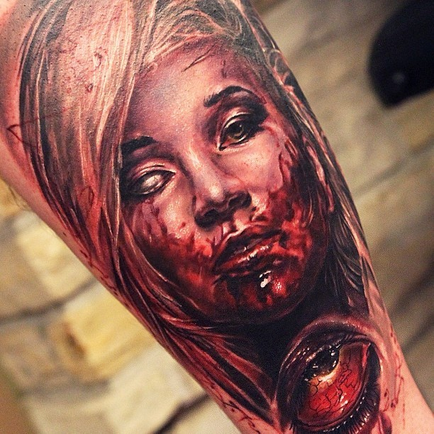 Colored and detailed horror bloody witch tattoo on arm
