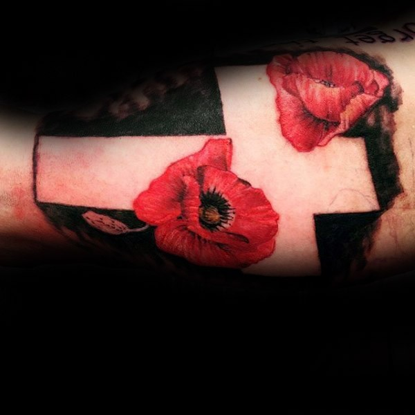 Colored arm tattoo of big white cross with flowers
