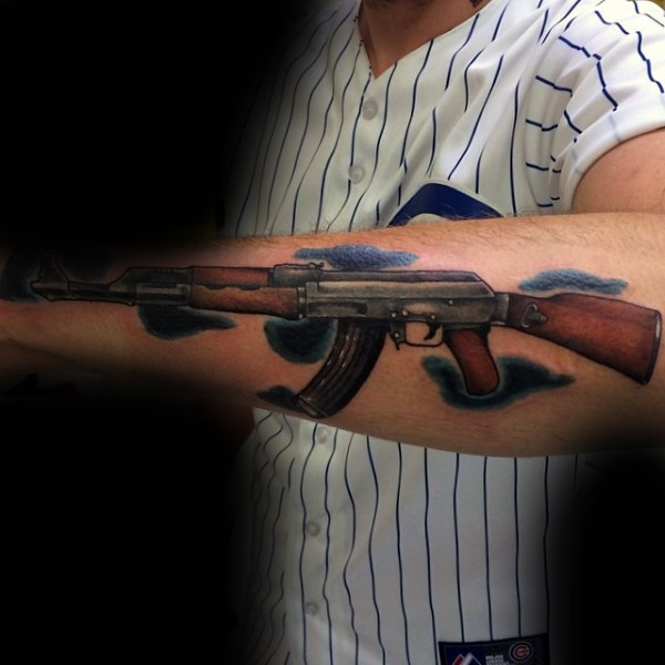 Colored arm tattoo of very detailed AK rifle with clouds
