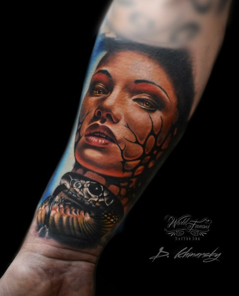 Colored awesome looking arm tattoo of woman face with snake