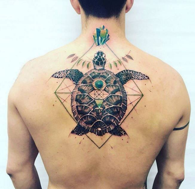 Colored awesome looking colored upper back tattoo of big turtle with ornaments