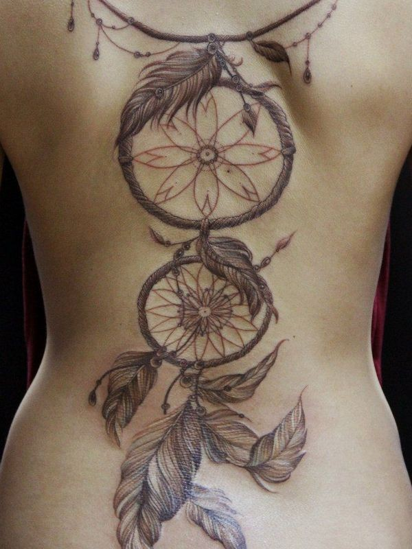 Colored back tattoo of dream catcher with feather