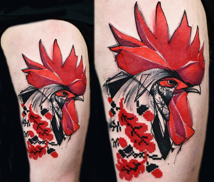 Colored beautiful looking thigh tattoo of cock head with ornaments