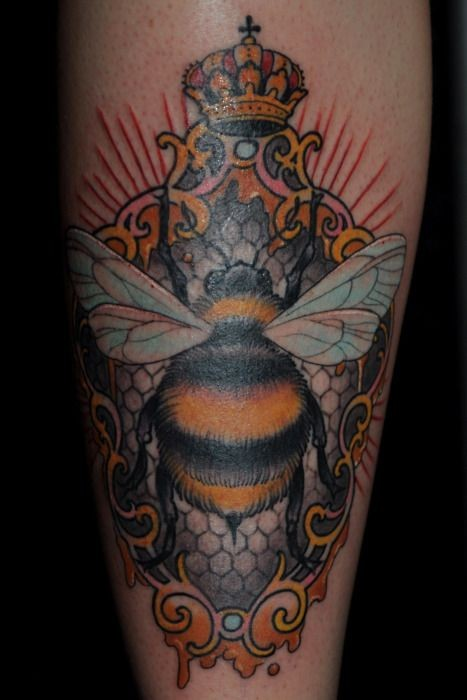 Colored bee  with crown tattoo on leg