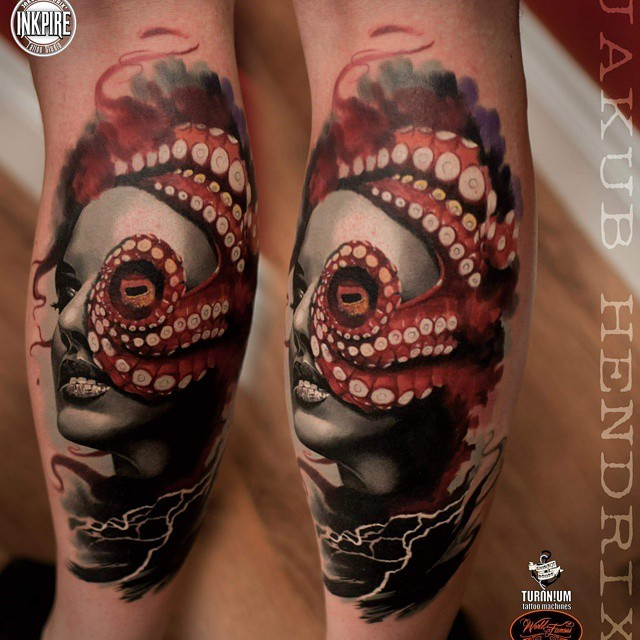 Colored biceps tattoo fo woman face with sea star