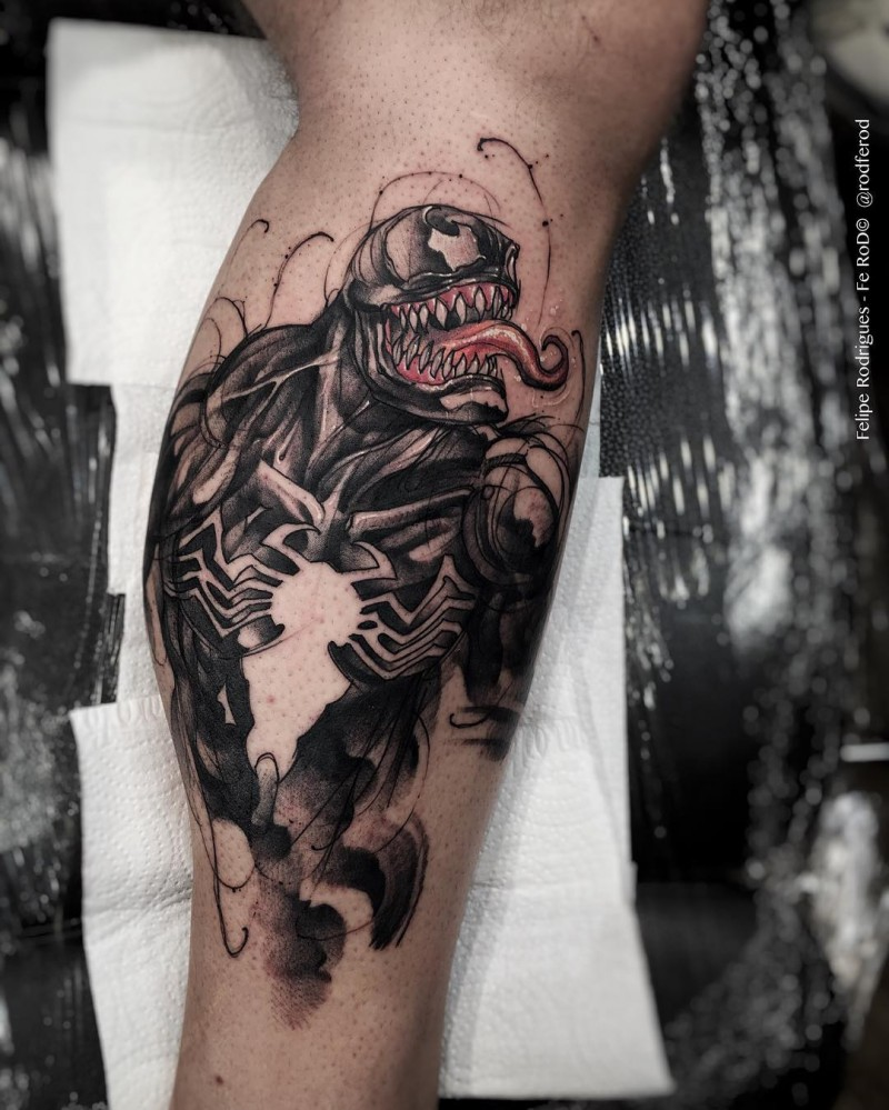 Colored biceps tattoo of very detailed Venom