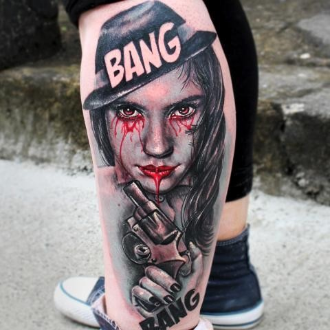 Colored bloody leg tattoo of woman with pistol and hat with lettering