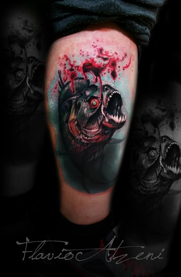 Colored bloody looking tattoo of creepy fish