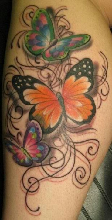 Colored butterfly tattoo on the foot