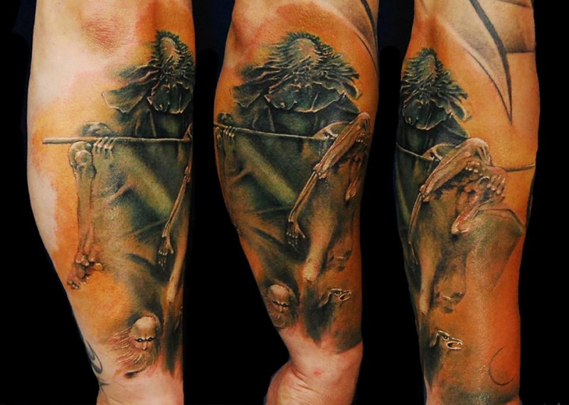 Colored creepy looking arm tattoo of creepy monster