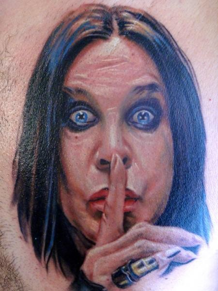 Colored creepy looking famous singer portrait tattoo