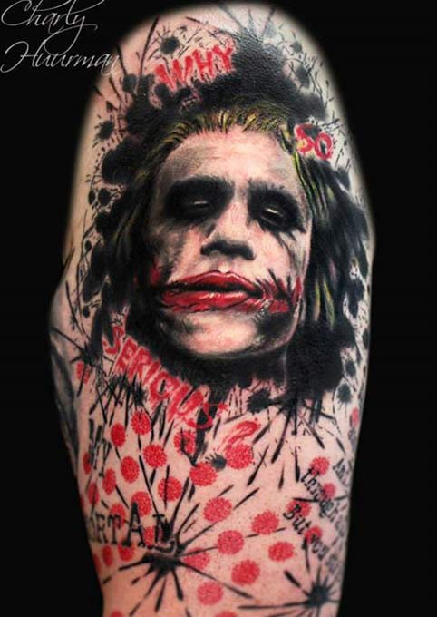 Colored evil Joker face tattoo with lettering