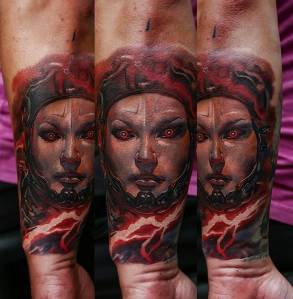 Colored evil looking arm tattoo of alien woman with flame