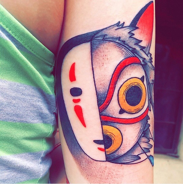 Colored famous monster cartoon heroes faces tattoo on biceps