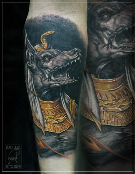 Colored fantasy style forearm tattoo of creepy Egypt God