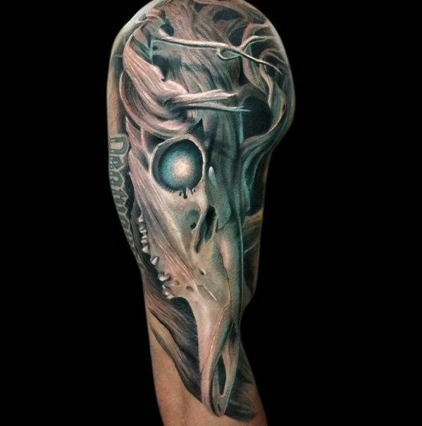 Colored fantasy style shoulder tattoo of demonic animal skull