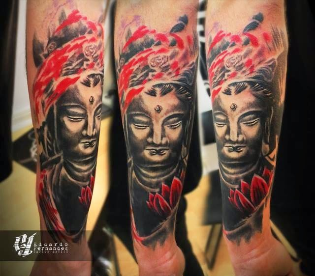 Colored forearm tattoo of Buddha statue