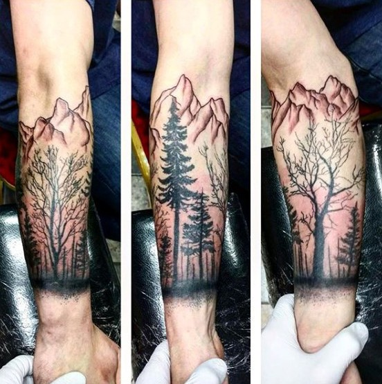 Colored forearm tattoo of typical mountain forest