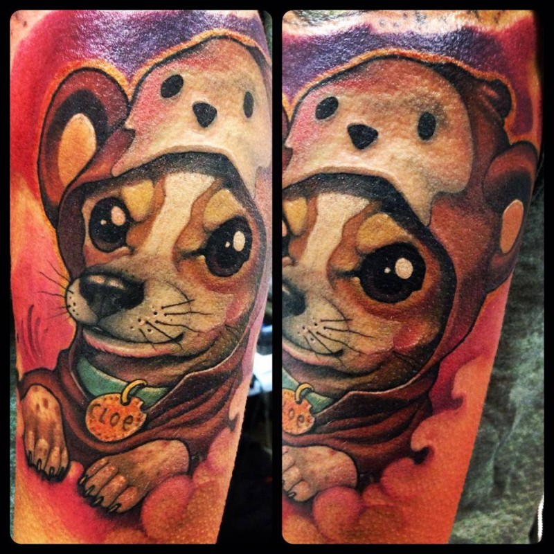 Colored funny looking arm tattoo of cute little dog with funny hat
