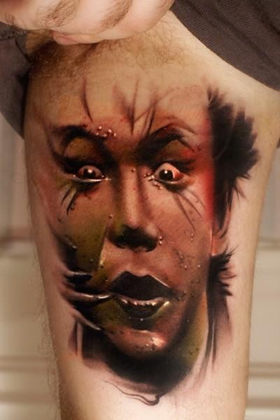 Colored horror style arm tattoo of creepy looking man